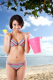 Black bikini woman at the beach. A beautiful black woman in bikini at the beach royalty free stock photo