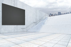 Black billboard and stairs. Side view of black billboard and concrete staircase on city background. Mock up, 3D Rendering Stock Photography