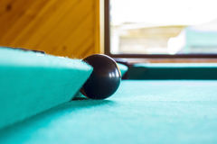 Black billiard ball. Royalty Free Stock Images