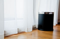 A black bin at the window Royalty Free Stock Photo