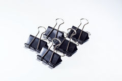 Black binder clip isolated Stock Photography