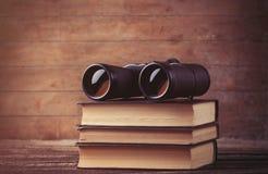 Black binocular and books Stock Photos
