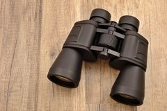 Black binocular. On the desk royalty free stock image