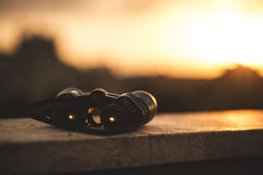 Black Binocular on Grey Concrete Frame Royalty Free Stock Photography