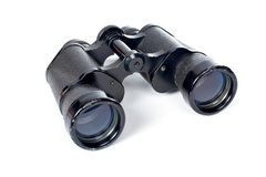 Black binoculars. Used black binoculars with shadow on a white background. Shallow DOF Royalty Free Stock Photography