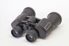 Black binoculars insulated on light background Royalty Free Stock Photos