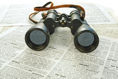 Black binoculars and news Stock Image