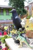 Black Bird and Dinosaur Stock Photos