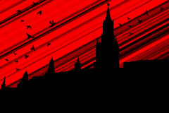 Black birds over the Kremlin. Black birds over the dark Kremlin against the background of the bloody sky Stock Photo