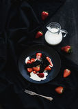 Black biscotti and strawberry dessert with sweet Stock Images