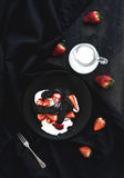 Black biscotti and strawberry dessert with sweet Royalty Free Stock Photos