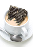 Black biscuits dipped in coffee with milk Royalty Free Stock Photos