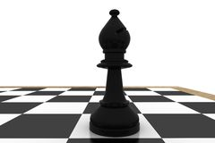 Black bishop on chess board Royalty Free Stock Image