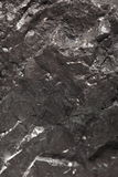 Black bituminous coal, carbon nugget background Stock Photos