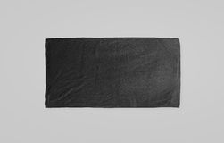 Black black soft beach towel mockup. Dark unfolded wiper. Mock up laying on the floor. Shaggy fur bath textured jack-towel top view. Domestic cloth kitchen Royalty Free Stock Image