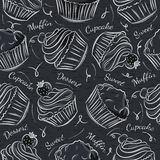 Black blackboard with cupcakes Stock Images
