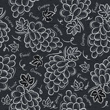 Black blackboard with grapes Stock Photos