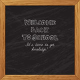 Black blackboard greeting card welcome back to school with woode Royalty Free Stock Image