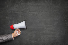 Black blank blackboard with hand holding megaphone Stock Photos
