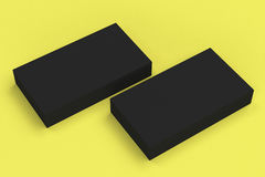 Black blank business cards mock-up on yellow background Stock Photo
