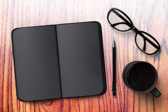 Black blank diary with cup of coffee and glasses Stock Image