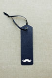 Black blank gift tag with mustache Royalty Free Stock Photos