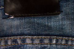 Black blank lather label on jeans Stock Photos