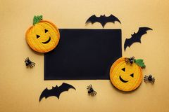 Black blank paper card with decorative pumpkins, spiders and bat Stock Photo