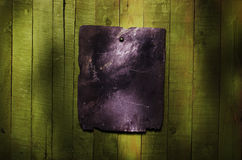 Black blank stone with copy space on green wooden table. Stock Images