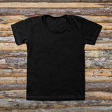 Black blank t-shirt on wooden background Stock Photos