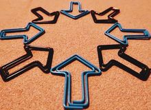 Black and Blue Arrow Paperclips Forming a Star stock images