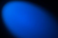 Black and blue background lighted with snoot Stock Photos