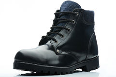 Black with blue boot Royalty Free Stock Images