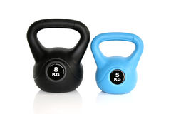 Black and blue kettlebells on white background Royalty Free Stock Image