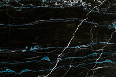 Black and blue marble texture. Black and blue natural marble flat surface close-up texture royalty free stock image