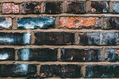 Black, Blue, and Orange Concrete Brick Stock Image