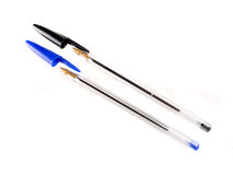 Black and blue pallpoint pens. On white background Royalty Free Stock Photos