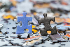 Black and blue puzzle pieces Royalty Free Stock Image