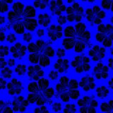 Black on blue random hibiscus flower seamless repeat pattern background. Two colour random hibiscus flower seamless repeat pattern background. Could be used for Stock Photo