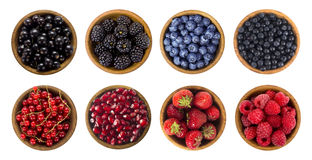 Black-blue and red berries. Collage of different fruits and berries isolated on white. Blueberry, blackberry, cherry, strawberry, currant and raspberry Stock Image