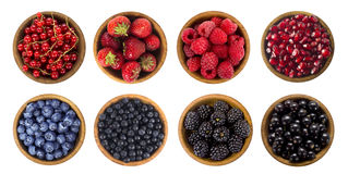 Black-blue and red berries isolated on white background. Collage of different fruits and berries. Blueberry, blackberry, cherry, strawberry, currant and Royalty Free Stock Photos