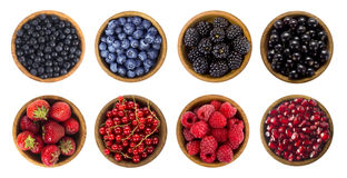 Black-blue and red berries isolated on white background. Collage of different fruits and berries. Blueberry, blackberry, cherry, strawberry, currant and Royalty Free Stock Photography