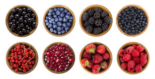 Black-blue and red berries isolated on white background. Collage of different fruits and berries. Blueberry, blackberry, cherry, strawberry, currant and Stock Images