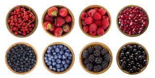Black-blue and red berries isolated on white background. Collage of different fruits and berries. Blueberry, blackberry, cherry, strawberry, currant and Stock Photo
