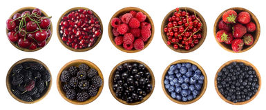 Black-blue and red berries isolated on white background. Collage of different fruits and berries. Blueberry, mulberry, bilberry, blackberry, cherry, strawberry Stock Images