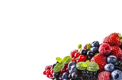 Black-blue and red food on a white. Ripe blackberries, blueberries, currants, raspberries, strawberries with mint on a white backg. Round. Mixed berries with royalty free stock image