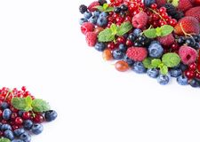 Black-blue and red food on a white. Ripe blueberries, currants, raspberries, strawberries with mint on a white background. Mixed b. Erries with copy space for Stock Photography