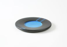 Black and blue saucer Stock Photo