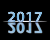 2017 on black. Blue text graphics 2017 on black with reflection Royalty Free Stock Photo