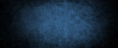 Black and blue vintage background with distressed grunge texture and soft color design with dark black border